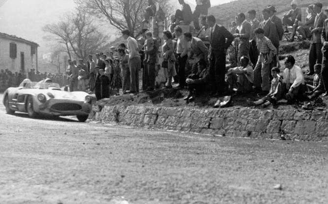 Stirling-Moss-and-Denis-Jenkinson-Mercedes-Benz-300-SLR-in-1955-Mille-Miglia-front-three-quarter-2