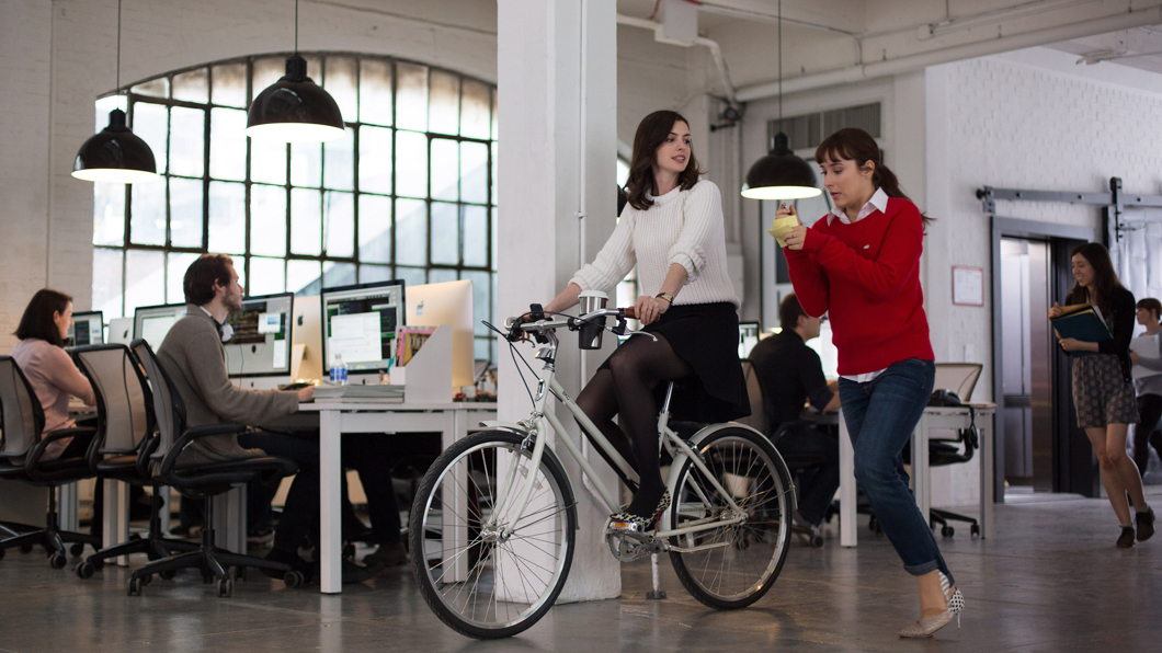 "This photo provided by Warner Bros. Pictures shows, Anne Hathaway, left, as Jules Ostin, and Christina Scherer as Becky, in scene from the comedy, ""The Intern,"" a Warner Bros. Pictures release. (Francois Duhamel/Warner Bros. Pictures via AP)"